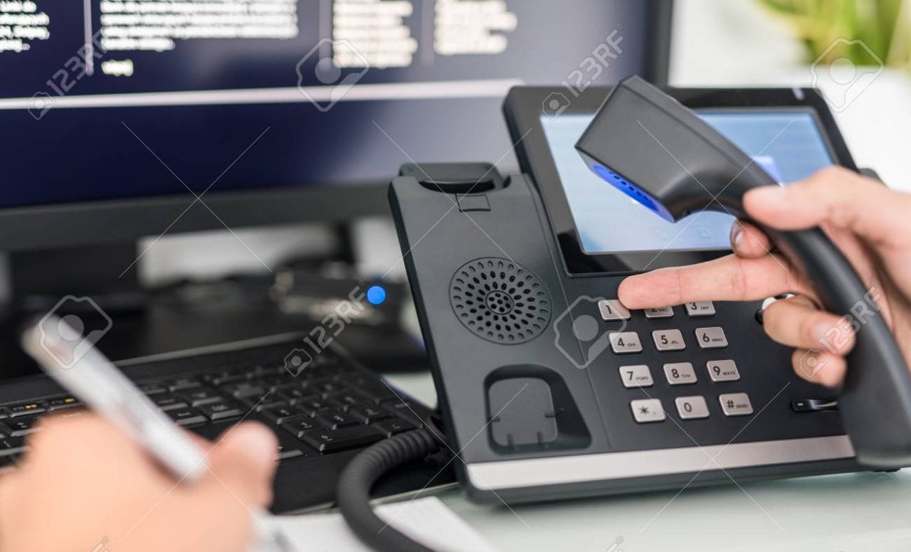 92990694 communication support call center and customer service help desk voip headset on laptop computer key scaled